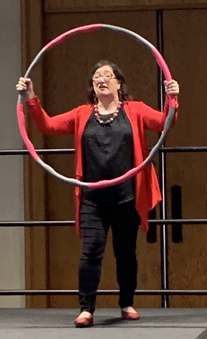 Amy Waninger using a hula hoop during a speaking engagement to illustrate what can and cannot be controlled. (photo provided)
